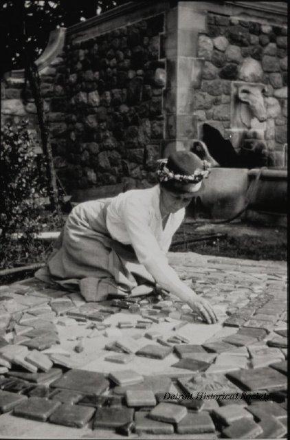 Mary Chase Perry Stratton installing Pewabic Pottery tiles, 1920 - 2014.002.088